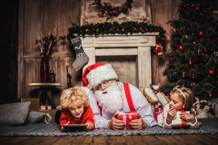 Happy Santa Claus with children