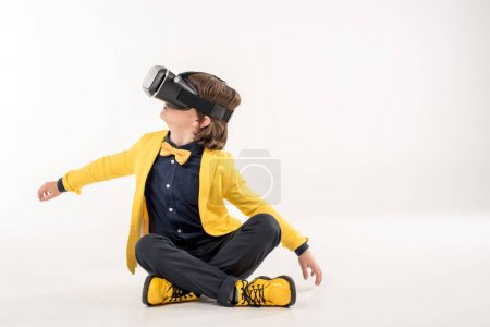 Child in virtual reality headset