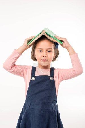 Schoolgirl standing with open book