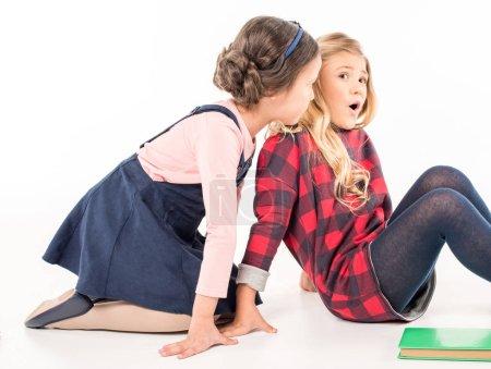 Schoolgirls sitting and talking