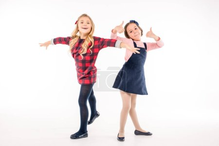 Schoolgirls playing and gesturing