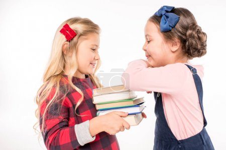 Smiling schoolgirls standing with books
