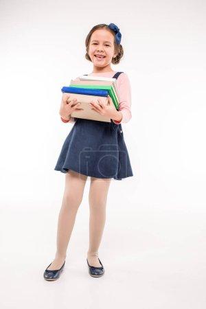 Schoolgirl holding books