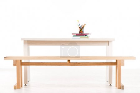 Desk with books and school supplies