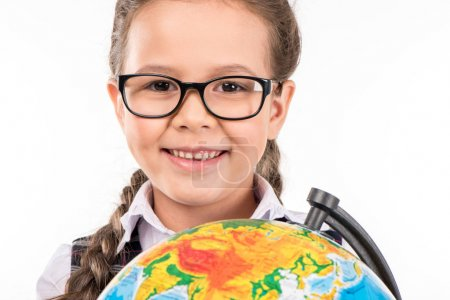 schoolgirl smiling with globe