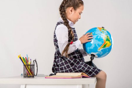 Schoolgirl using globe