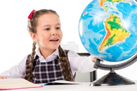 Schoolgirl looking for something on globe