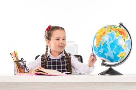 Schoolgirl doing homework and using globe