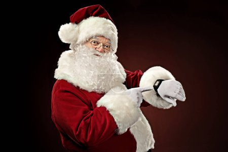 Santa Claus pointing on smart-watch