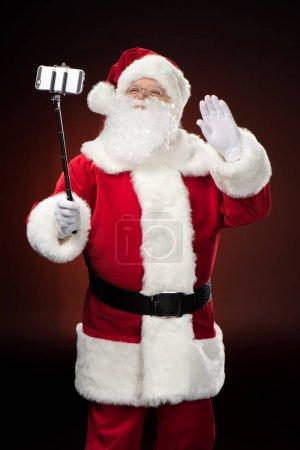 Happy Santa Claus taking selfie