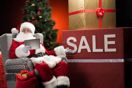 Santa Claus with Sale sign