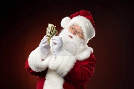 Santa Claus counting dollar banknotes