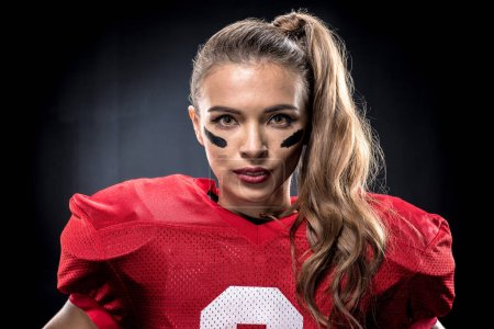 Female american football player in uniform