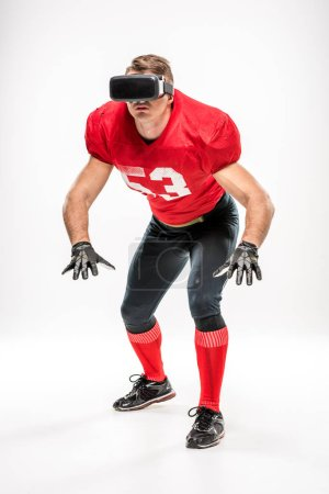 Football player in virtual reality headset