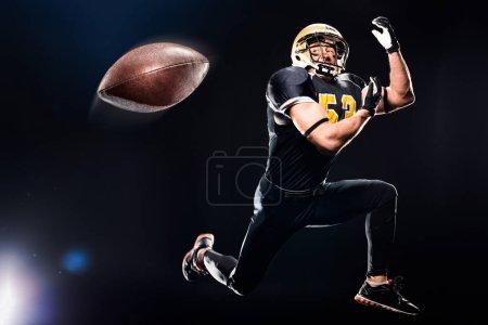 Football player catching ball