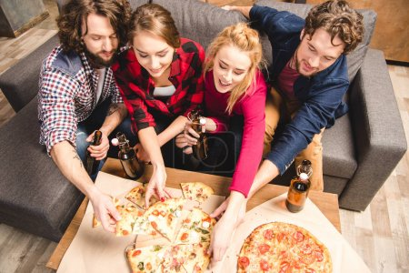Happy friends enjoying pizza