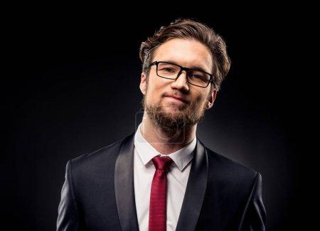 Smiling businessman in eyeglasses