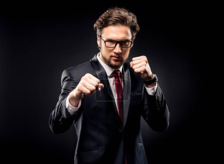 Aggressive businessman punching