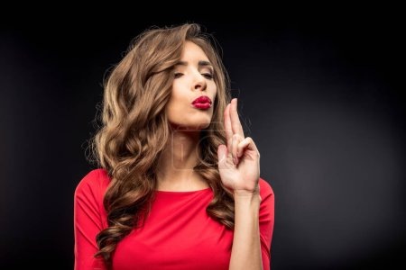 Woman in red dress gesturing
