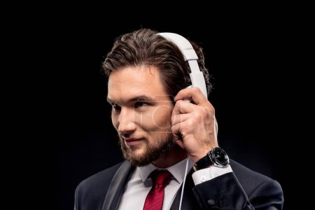 Handsome businessman in headphones