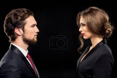 Serious couple in formal wear