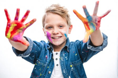 Excited schoolboy artist