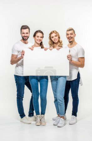 Friends holding blank card