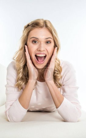 Excited blonde woman
