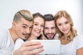 Happy friends taking selfie