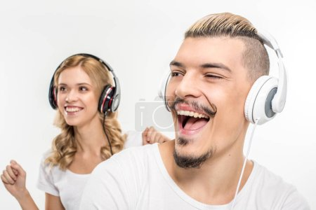 Young couple in headphones