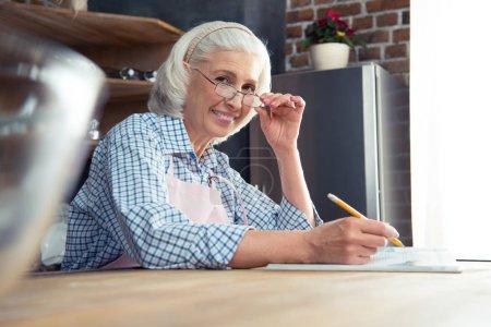 Senior woman with cookbook