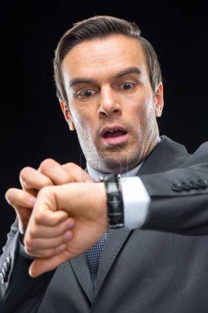 Scared businessman with wristwatch