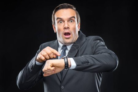Scared businessman with wristwatch
