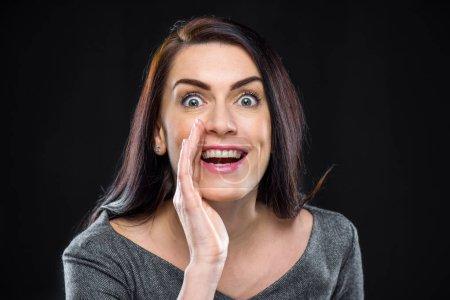 Woman telling secret