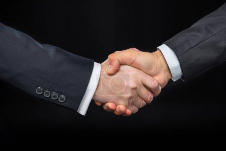 Businespeople shaking hands