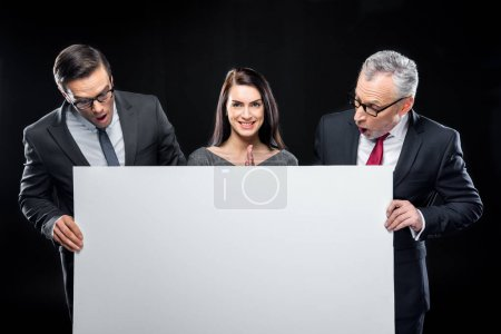Businespeople holding blank card