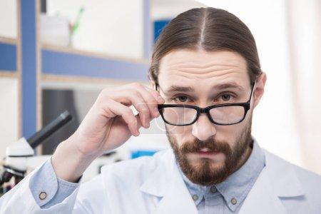 Male scientist in eyeglasses