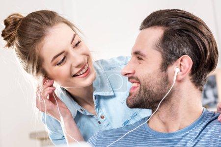 Smiling couple with earphones