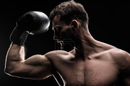Sportsman in boxing glove