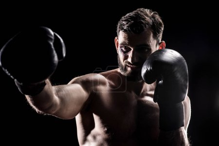 Young boxer in gloves