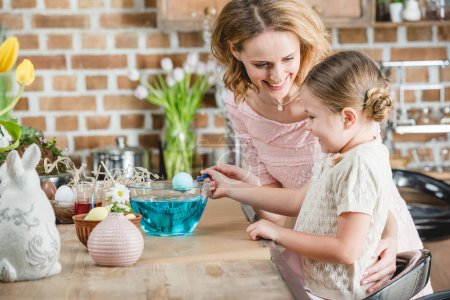 Woman and girl preparing for Easter