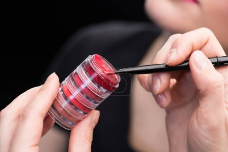 Make-up artist with lip cream