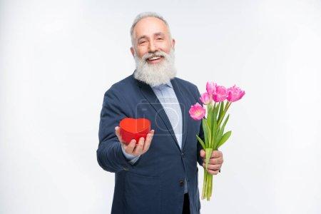 Senior man with tulips