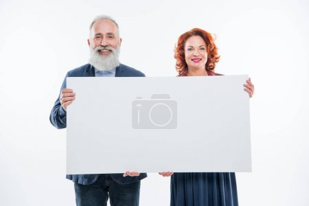 Couple holding blank card