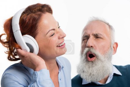 Mature couple with headphones