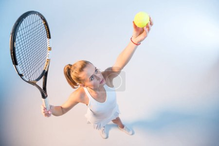 Woman with racket and ball