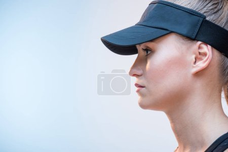 Woman in black cap