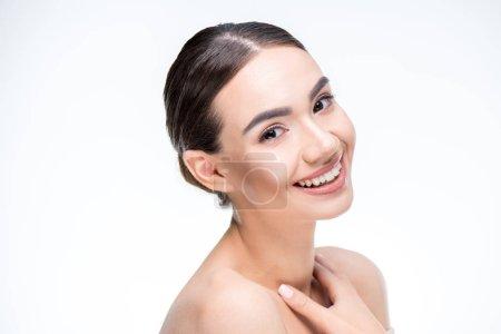 Woman smiling and looking at camera