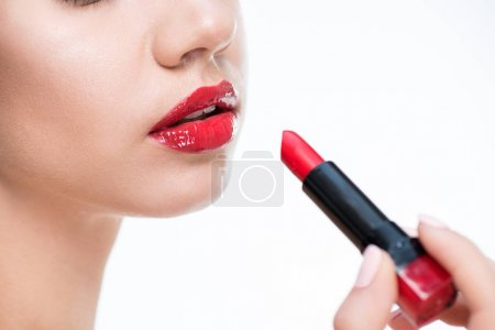 Woman holding red lipstick