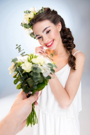 Woman receiving flowers